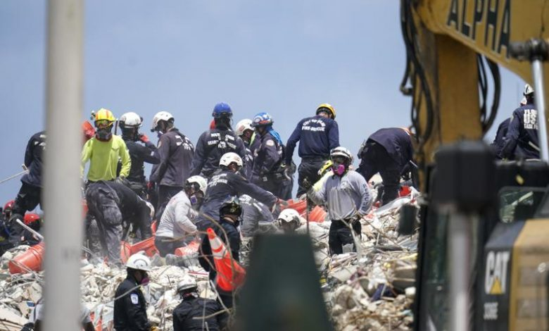 Crews spend 5th day atop shaky pile of collapsed concrete