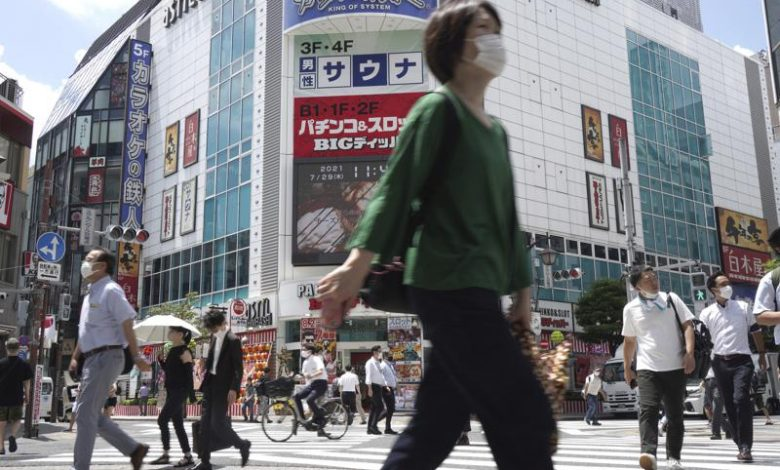 Officials in Tokyo alarmed as cases hit record highs