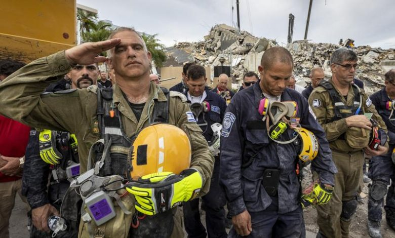 Recovery workers pledge to press forward in condo collapse