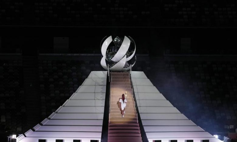 Tokyo Olympics begin with muted ceremony and empty stadium
