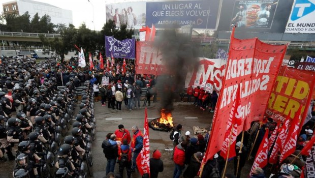 Protesters march to the Ministry of Social Development.