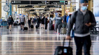 Passengers at Ronald Reagan National Airport in Arlington,