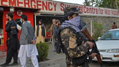 Taliban fighters block a street in Kabul after a bomb attack in the capital.